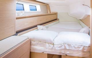 bedroom with double bed and storage compartments luxury boat hire italy la spezia liguria