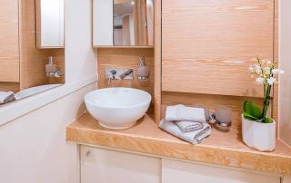 close up of sink mirror and closet bathroom hire a yacht in italy la spezia