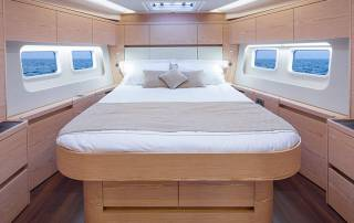 comfortable cabin with double bed and windows with seaviews yacht charter italy with skipper