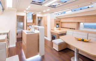 cosy wooden sitting area and kitchen in cabin luxury yacht charter liguria italy
