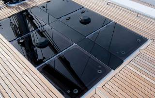 hatch in teak deck providing natural light in yachts interior hanse 588