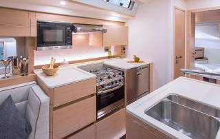 kitchen in yacht well equipped with multiple storage compartments sink fridge perfect for luxurious sailing holiday in italy