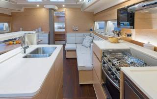 kitchen with oven kitchen stove sink fridge and other appliances in cabin of hanse 588 sailing boat italy