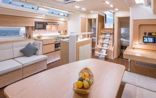 lounge area with kitchen bar seats table comfortable luxury sailing in italy liguria la spezia
