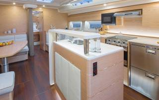 lounge area with well equipped kitchen and bar comfortable interior in luxury sailing yacht italy