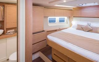 master bedroom with standalone double bed private bathroom windows seaview yacht charter italy