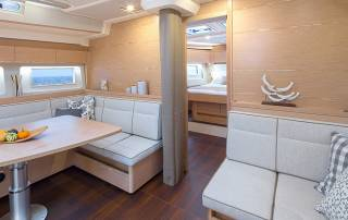 sitting area yacht with foldable table and windows with seaview hanse 588 sailing yacht la spezia italy