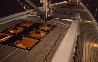 teak deck with deck hatches mast with lines yacht charter italy